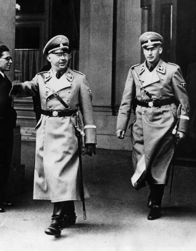 Heinrich Himmler, left, chief of the German secret police, and his aide, Reinhard Heydrich are seen in Vienna in 1938 after Hitler took over Austria.  (AP Photo)