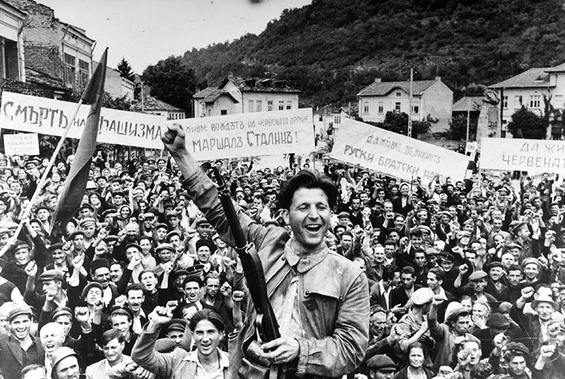 Cheering and posters for Soviet general Stalin at a rally in Bulgaria in autumn 1944.   Photo: Yevgeny Khaldeinull